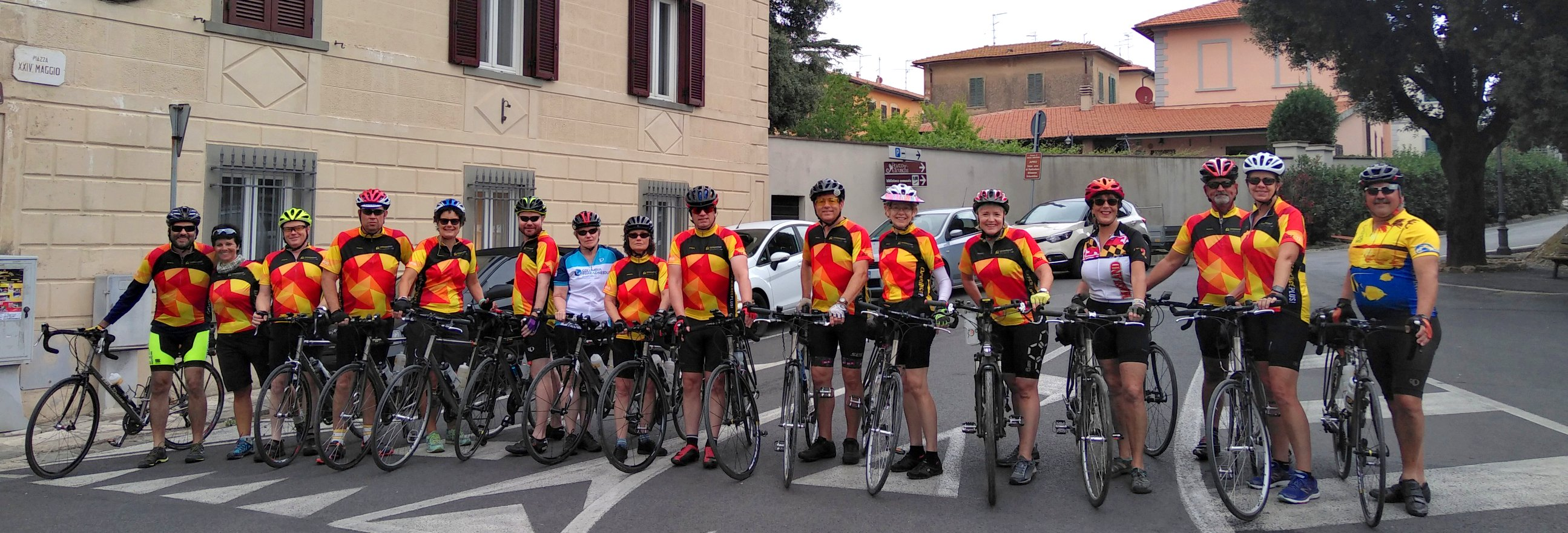 A group lines up for a photo shoot on their Hidden Tuscany guided bike tour.