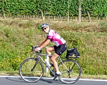 Riding through vineyards in Tuscany with ExperiencePlus