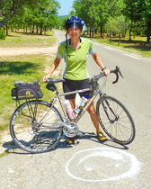 Sally and a smile face - a small reward for a 9km hill climb