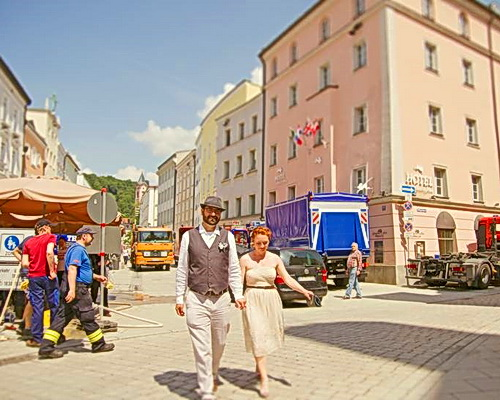 Nadine and Nathan walking through Passau while flood mitigation crews work. Photo by Gasoline Photography